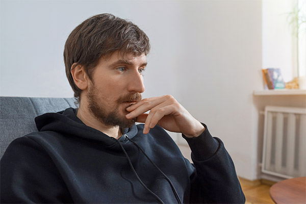 Young man looking away from camera in deep thought