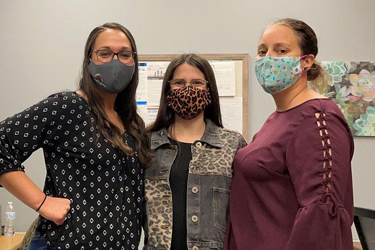 Three OneEighty staff members wearing masks
