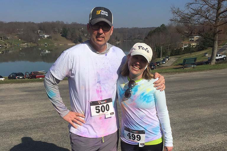 Two Participants in the Color Run posing for photo